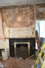 <h5>Dining Room</h5><p>Wallpaper stripped over Victorian fireplace																																																																																																																																																																										</p>