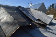 <h5>wind blew off the roof of an outbuilding</h5><p>																																																																																																																																								</p>